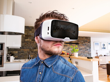 Adult male wearing a VR headset standing in living room