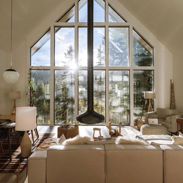 We are loving this Scandinavian inspired cabin in Montana! Stunning floor to ceiling A-framed windows surrounded by a lush forest. There is something so peaceful about having a cabin in the woods. Once we can travel, this one will most definitely be on our winter list! #ResidentExperts