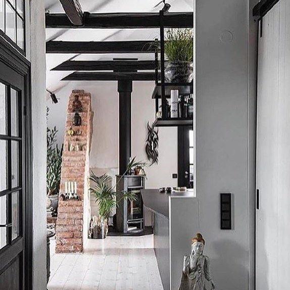 Did someone say Scandinavian design? Huge hygge alert!! This space is cozy yet refined with the original exposed brick separating the space, high vaulted ceilings and wooden beams, and we can't get enough of it. *swoon*